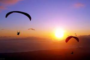 paraglidingtothesunset
